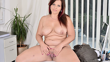 Curvy milf Riona takes a break and fingers her luscious hole