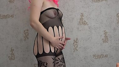 Milf in early pregnancy in sexy pantyhose masturbates with a dildo.